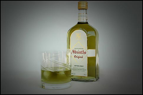 Original Absinthe bootle with absinthe drink on ice.